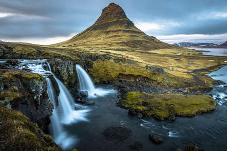 Kirkjufell mountain the iconic tourist attraction in west region of Iceland.