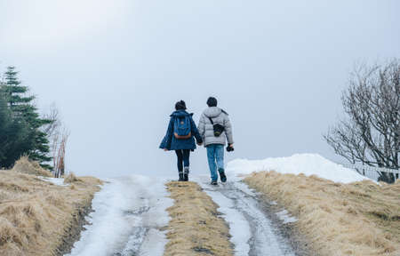 Back view of lovely couple holding each other hands, travelling in Iceland during the winter. 版權商用圖片