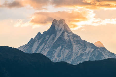 Machapuchare mountain (Mt.Fish tail) one of the iconic peak in Annapurna conservation area of Nepal. The unclimbable Nepalese mountain of Machapuchare, one of the least-visited places on Earth. Reklamní fotografie