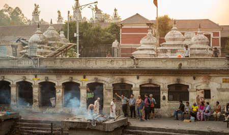 KATHMANDU, NEPAL - APRIL 17 2016: Hindu Cremations at Pashupatinath Temple in Kathmandu Nepal.