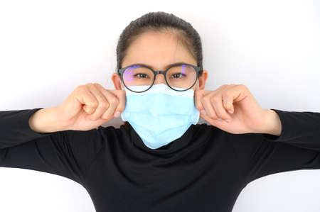 Shot of young Asian woman worring and wearing mask for protect bad air pollution or virus. Air pollution has been associated with diseases of the heart and lungs, cancers and other health problems.