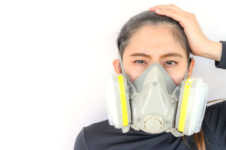 Portrait of young Asian woman wearing gas mask for protect smog bad air pollution or toxic. Air pollution has been associated with diseases of the heart and lungs, cancers and other health problems.