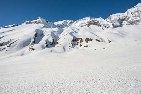 The big snowfield covered on steep slope after avalanche hit Annapurna base camp in Nepal. The Annapurna trek is a trek within the mountain ranges of central Nepal.