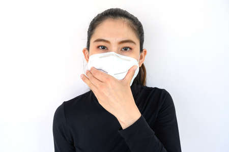 Portrait of young Asian woman wearing N95 mask for protect smog PM2.5 bad air pollution. Air pollution has been associated with diseases of the heart and lungs, cancers and other health problems.