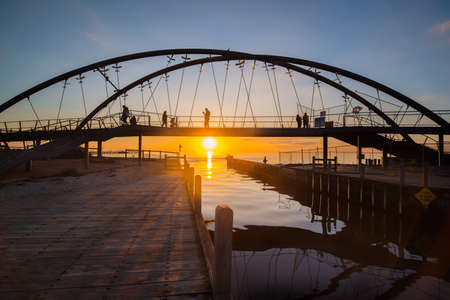 The beautiful sunset over the bridge in Frankston beach one of the suburbs in Melbourne, Australia. Frankston is one of Melbourne's fastest growing suburbs with new and improved attractions.