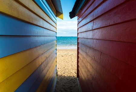 Sea look through from the side of bathing boxes on Dendy Street Beach, Brighton beach of Melbourne.
