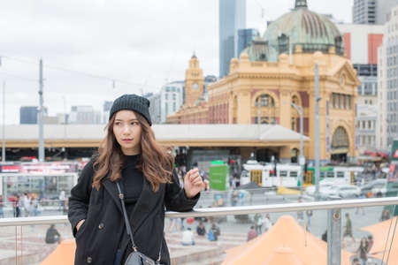 Portrait of Asian woman traveling in Melbourne the most liveable city in the world in Victoria state of Australia.