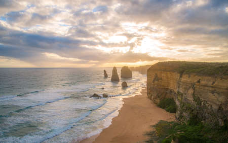 Twelve Apostle the iconic rock formation in the Great Ocean Road of Victoria state, Australia at sunset. 12 Apostles is breath-taking in splendour with its dramatic, rugged cliffs carved from the sea.