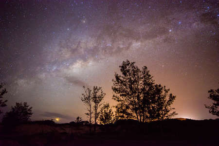 The Milky Way galaxy in the starry night sky of Northern Territory state of Australia. The Milky Way is a barred spiral galaxy, about a hundred light-years across. 免版税图像