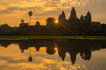 The silhouette of Angkor Wat before sunrise in Siem Reap province of Cambodia. Angkor Wat was built in the first half of the 12th century (113-5BC).