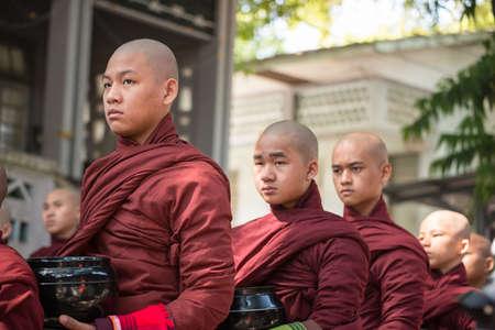 AMARAPURA, MYANMAR - OCT 15 2014: Myanmar novice in Mahagandayon Monastery of Amarapura the old capital of Myanmar.