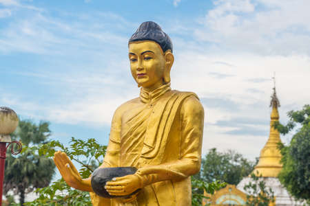 The Buddha statue in Burma style in Bago town of Myanmar. Buddha statues are the representations of Lord Buddha himself.