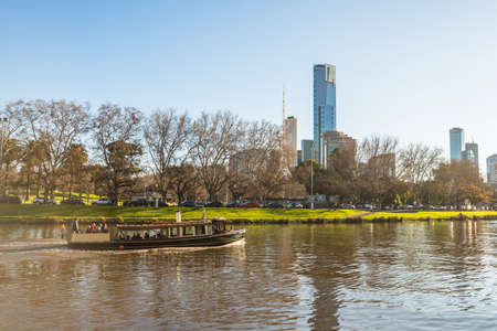 Melbourne, Australia - October 14 2015: Tourist traveling by boat along the Yarra river to see the view of Melbourne the most liveable city in the world.