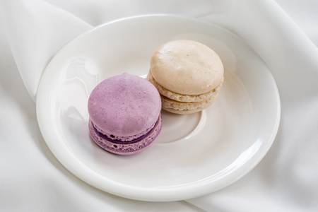 maroni: Colorful french macarons on the plate.