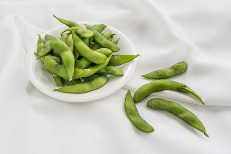 nibbles: Edamame nibbles, boiled green soy beans, japanese food.