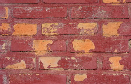 stonework: Weathered texture of stained old dark brown and red brick wall background, grungy rusty blocks of stone-work technology, colorful architecture