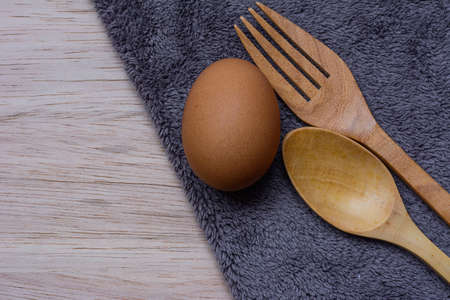 microfiber cloth: Fresh eggs on wooden and Microfiber Cloth background Stock Photo