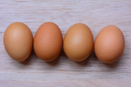 sackcloth: Fresh eggs on wooden background
