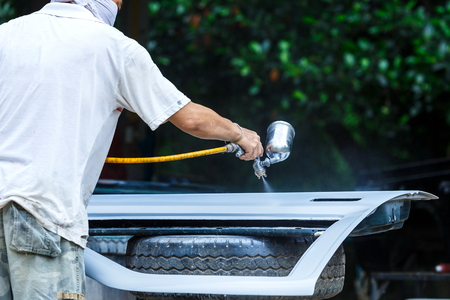Spray paint car mechanic,Car sprayer,paint repair work. Stock Photo