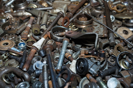 Spare parts scrap,Used spare parts wait for get rid or sell to recycle,Nuts Bolts. Archivio Fotografico