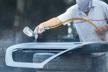 Spray paint car mechanic,Car sprayer,paint repair work. Stock Photo