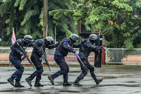 Commando Training,Special Operations Police,Police steel handcuffs,Police arrested,Professional police officer has to be very strong,Officer Arresting,Selective focus,noise. Stock Photo