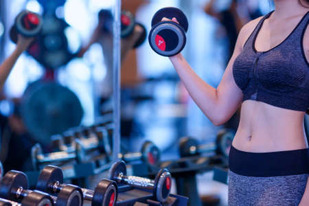 Shapely women exercise healthy in the gym;