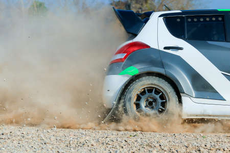 rally car running on dirt, rocks and dirt splashing into the camera,f2thailandrallychampionship21-22march2020,Soft focus,selected focus,shallow depth of field.