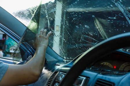 Car Films Installing windshield protection film blur.;