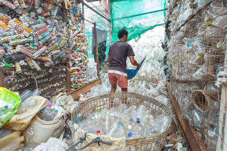 Lampang, Thailand June 8-2020 Waste sorting factory and buy antiques, recycle and store waste plastic bottles, paper, aluminum cans to reduce global warming,motion blur,overuse of noise reduction.