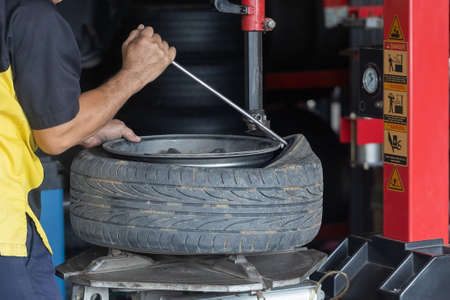 technician,Mechanic is retreating, replacing the tires and mag wheels in the service center. Stock fotó