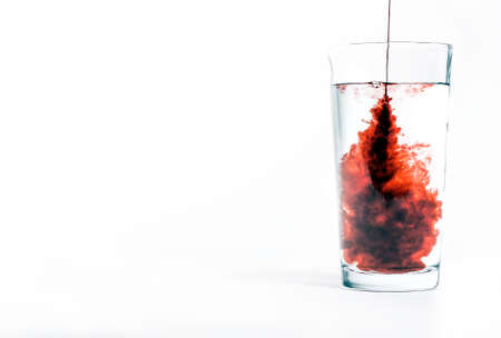 squirted: Flavoring squirted into a glass of water