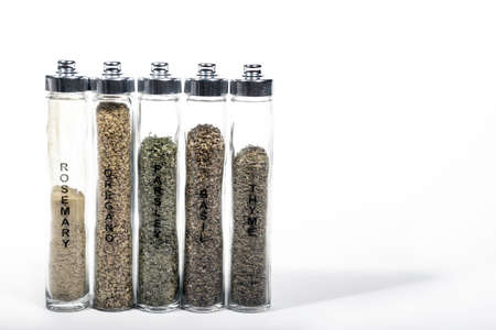 Herbs in tall glass containers Banque d'images