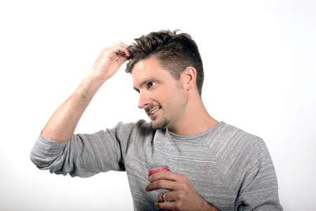 man applying hair product Stock Photo