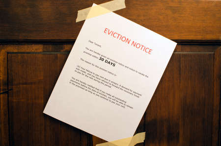 An eviction notice taped to a door  Banco de Imagens
