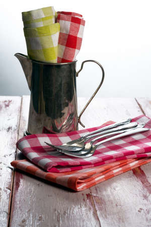 table surface: Checked cloth napkins on a rustic picnic table surface