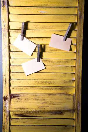 repurpose: A DIY message board made from recycled shutters and clothespins  Stock Photo