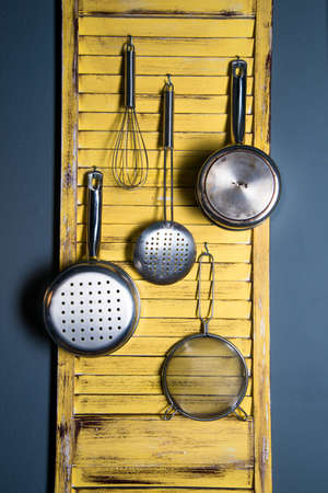 repurpose: A  kitchen organizer made from repurposed house shutters  Stock Photo