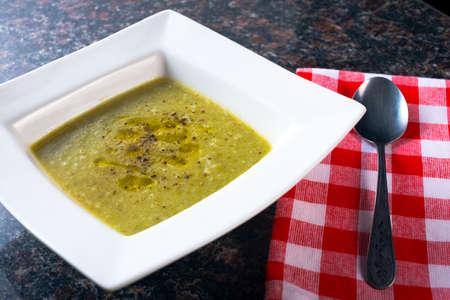 White bowl of Green bean healthy soup