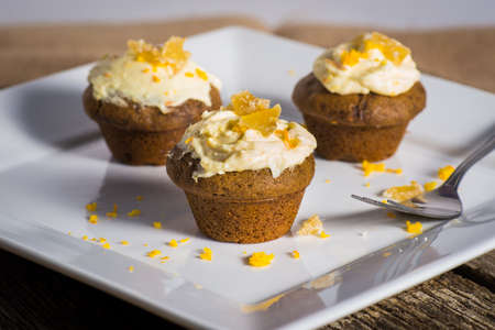 sweet and savoury: spicy candied ginger cupcakes with cream cheese frosting orange zest