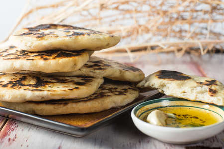 Stack of homemade fried Indian Naan bread.