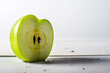 granny smith apple: Granny Smith Apple Slice on white rustic background