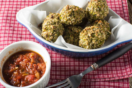 entree: Vegetarian no meat meatballs with broccoli and tomato dipping sauce