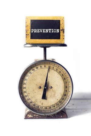 ounce: An ounce of prevention on a scale metaphor
