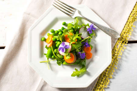 Colorful spring salad carrots peas fresh
