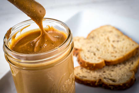 Freshly made peanut butter spread fat