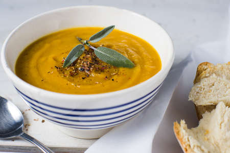 Bowl of butternut squash soup hearty