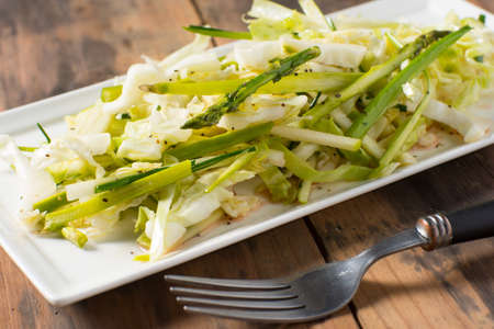 Plate of slaw salad asparagus and cbbage