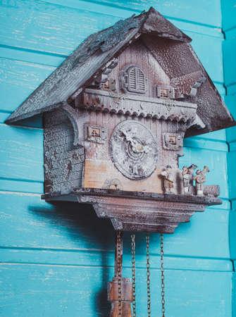 pendulum: Vintage cuckoo clock on the wooden backgraund