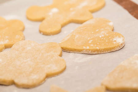 pastry cutters: Childrens hands make gingerbread from dough Stock Photo